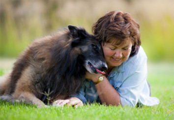 Loving Tervuren Belgian Shepherd with his owner.